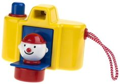 """Toddler Toys: My First Camera """"Focus Pocus"""" by Ambi Toys ft. in Baby Einstein Movies Children love to imitate the adults around them and the Ambi Focus Pocus Camera lets them do just that.. Press the button to """"take"""" a picture and a smiling clown pops out!. Every young child enjoys the action of this sturdy, plastic toy camera.. Encourages a child's imagination through pretend play fun.. Made by Ambi Toys in Europe.  Ages 12 months to 3 years.."""