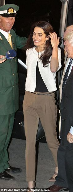 Amal Clooney touching her hair (again)