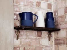 The wall shelf next to the French doors rests on Little Chap L Brackets. The ceramics are from the Conran Shop. Interior Design London, Painting Bathtub, Mobile Home Decorating, Small Shelves, Corner Shelves, Bathtub Remodel, Garage Makeover, Modern Staircase, Basement Remodeling