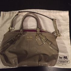 Authentic Coach Madison Beige Patent Handbag. A lovely, lightly used Madison style patent leather beige Coach handbag in good condition. Rarely used, and stored in the original silk bag, this handbag has a fun fuschia interior. There are a few marks towards the bottom of the bag, but otherwise looks in great condition. Coach Bags Satchels