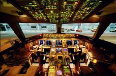 An inside view of a Boeing 777 cockpit.