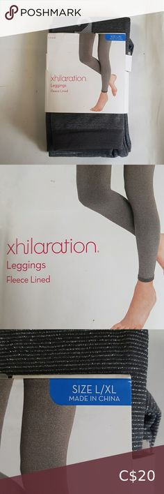 Exhilaration legging fleece lined full gray SzL/XL Nwt never all open Sz L/XL legging full fleece lined 83%polyster 7% Nylon 6% spandex Grey with sheen tread weave Brand new Please feel free to msg if any questions about this item,as it avoids returns and discrepancies Bundle up and save on shipping Open to offers Thanks for visiting Xhilaration Pants & Jumpsuits Leggings Fitbit, Leggings