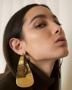 "<p><a href=""http://www.rafsimons.com/"">Raf Simons</a> turtleneck, <a href=""https://www.celine.com/en"">Céline</a> earrings</p>"