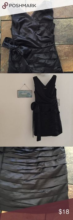 Express black dress with bow! Black dress with a bow on the large black bow on the side. Great condition. Only worn once! Express Dresses
