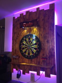 Dartboard backboard with backlight and Darts signYou can find Man cave bar and more on our website.Dartboard backboard with backlight and Darts sign Man Cave Room, Man Cave Diy, Man Cave Home Bar, Cave Bar, Rustic Man Cave, Garage Bar, Man Cave Garage, Garage Ideas, Bar Deco
