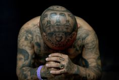 "A man nicknamed ""Oldies"" displays his tattoos by artist Josh Lin during the 8th International London Tattoo Convention on Friday. World famous tattoo artists and enthusiasts gathered for the annual event. Photo by Adrian Dennis/AFP/Getty Images."