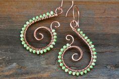 Pastel Green Earrings, Beaded pure copper spiral earrings, swirls, wire wrap with light green seed beads - handmade copper wirework jewelry. $19.00, via Etsy.