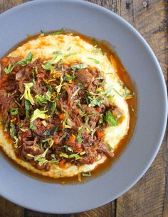 Anything that is meaty, has been braised for hours, and is then spooned over a creamy polenta is a winner in my book. This lamb ragu is no exception!