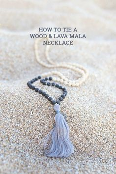 Learn how to tie a mala wooden bead necklace, and do a color block effect by adding lava beads. Finish it off with a big, bold tassel!