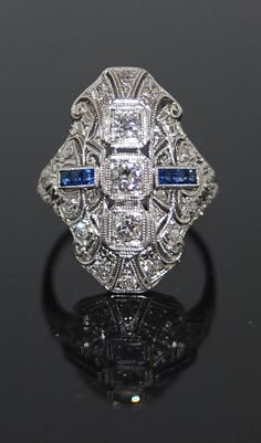 Love wouldn't mind an engagement ring that looks similar to this. Art Deco dinner ring.