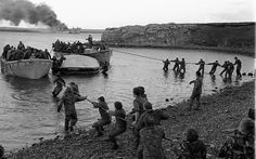 Survivors of the still burning HMS Sir Galahad are hauled ashore during the Falklands War. c.1982