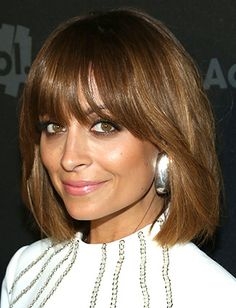 Add edge to a sleek, shoulder-length bob like Nicole Richie's with an embellished top and oversized earrings.