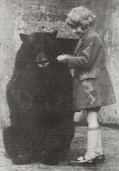 """Christopher Robin Milne and Winnipeg """"Winnie"""" the Bear at London Zoo, ca. 1926 (the original Christopher Robin with his Winnie the Pooh) Old Pictures, Old Photos, Bear Photos, Christopher Robin Milne, Winnie The Pooh, Le Zoo, Book Art, Pooh Bear, Interesting History"""