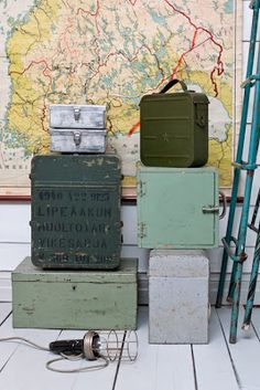 old trunks and cases infront of map, vignette home decor
