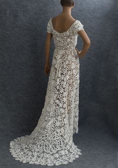 Which anniversary is the lace one again... a little much for renewing our vows but perhaps if I get Chris a new gun? :)... Irish crochet lace wedding dress, c.1912, from the Vintage Textile archives.