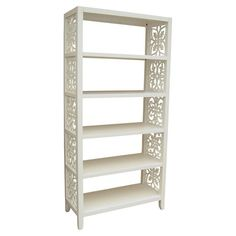 Stylishly stow your favorite novels in this chic bookcase, or set it in your master suite walk-in for extra shelving. Showcasing latticed sides and a white f...