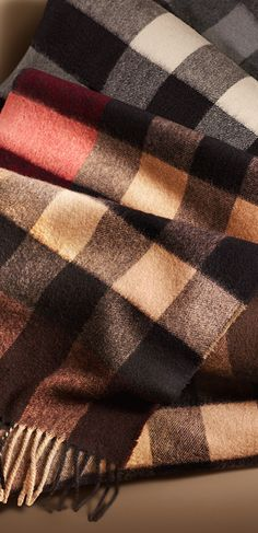 Wrap up from the cold in iconic Burberry check cashmere scarves