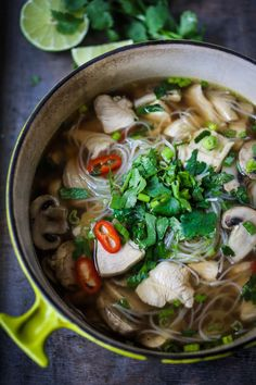 Steaming bowl of Thai Chicken Noodle Soup with Lemongrass ginger broth. Rice noodles makes this gluten free!!