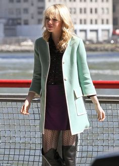 Strike a pose: Wearing a three-quarter-length sleeve mint green coat Emma looked sublime as she echoed the 1960s with the chic style