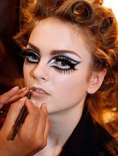 Exaggerated mod makeup backstage at Dior Fall 2008. Stark contrast, cut crease, false eyelashes, nude lips. Love.