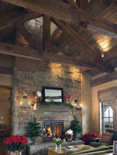 Hand hewn #dry_stack #stone #fireplace facade with hand hewn rustic wood rafters ~ kitchen, north wall.