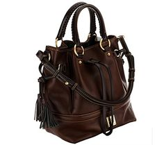 Fun, functional, and fashionable--the Dooney & Bourke Buckley bag is all-around fabulous! A drawstring keeps the bag closed, with flirty tassels hanging off to the side. From Dooney & Bourke. QVC.com