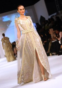 A model presents a creation by Moroccan designer Zhor Rais during the 2013 Muscat Fashion Week in the Omani capital late on January 15, 2013.  AFP PHOTO/MOHAMMED MAHJOUB