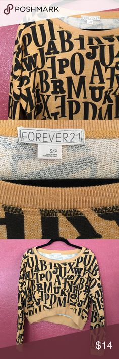 NWOT Forever 21 alphabet sweater New with tags, never been worn 💫 Size S by Forever 21 •  mustard color with black alphabet letters on a crop top design (nothing wrong with it, selling to make more room) Forever 21 Sweaters Crew & Scoop Necks