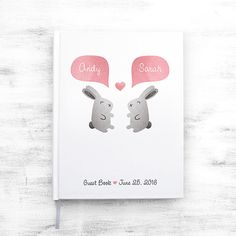 """★ Plan to check your Etsy Conversations to approve your proof ★  - 1 guest book - Personalized with your names and event details - White hard casebound cover with durable matte lamination - 0.25 white grosgrain bookmark ribbon, plus H&T bands - Text printed on the white areas is dark gray  VERTICAL book is... - 8.25 x 10.5"""" / with 0.625 spine - 100 blank pages (50 sheets) - 70# text white paper  HORIZONTAL book is... - 11.25 x 8.75"""" / with 0.5 spine - 80 blank pages (40 sheets) ..."""