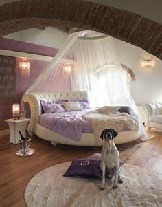Loving the rounded bed and headboard with the canopy over it!