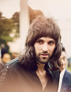 British musician Serge Pizzorno of Kasabian wearing Burberry to attend the Menswear S/S14 show in London