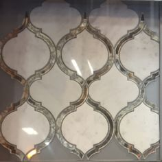 Just the most gorge tile I've ever seen. Marble & antique mirror... Ugh $50/sf not sure if we can do it even in a small framed accent area lol