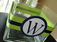 Wedding centerpieces with ribbon and a monogram Banquet Centerpieces, Glass Centerpieces, Wedding Centerpieces, Wedding Decorations, Birthday Centerpieces, Fish Centerpiece, Vase Decorations, Anniversary Centerpieces, 50th Anniversary