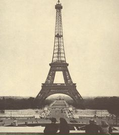 A Mosquito flown by the RCAF 409 Squadron, flies underneath the Eiffel Tower. Picture taken on September 14th, 1944.