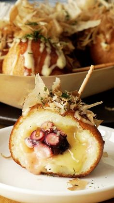 Recipe with video instructions: Elevate this traditional Japanese street food by wrapping it in cheesy potato goodness. Ingredients: 200g octopus, 300g potatoes, 10g potato starch, 1/2 tsp salt, 50g shredded cheese, 150g pancake mix, 140ml milk, 1 tbsp mayonnaise, oil for frying, (toppings), takoyaki sauce, mayonnaise, aonori (dried seaweed), bonito flakes