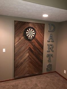 Wooden dart board wall in the man cave or game room. Basement Makeover, Basement Renovations, Home Remodeling, Basement Remodel Diy, Game Room Basement, Basement House, Basement Ideas, Gameroom Ideas, Diy Basement Furniture