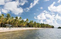 Perfect day to lounge by the #beach in Islamorada, Florida. -Travel and Leisure