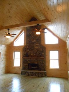 Floor To Ceiling Fireplace, Custom Rock Finish, Accent Hewn Beam Surround