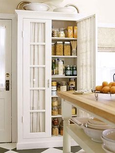 Dishfunctional Designs: The Upcycled Armoire, thinking ikea cabinet with molding and sheers