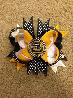 """""""Childhood Cancer Awareness boutique bow on Etsy, $10.00"""" This amazing bow is no longer available but could try replicating it!"""