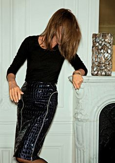 Carine Roitfeld in leather skirt at her apartment
