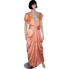 This is an extraordinarily beautiful Edwardian (1890-1910) apricot charmeuse  and silk chiffon gown with many hand-sewn details with couture