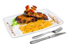 Coaste de porc marinate si cartofi prajiti. Detalii la http://www.casavanatoreasca.ro/meniu/