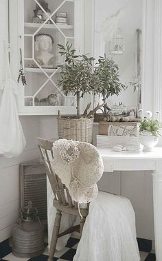 Love soft whites, greens, and taupes. Look for busts and vintage items like the lovely crocheted hat. ~ Jeanne D'Arc Living and Isla