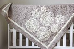 use a store bought quilt to sew on heirloom doilies.
