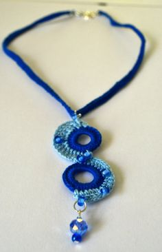 short blue and turquoise crochet s-shaped pendant necklace