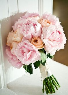 Beautiful bouquet with light pink peonies and garden roses
