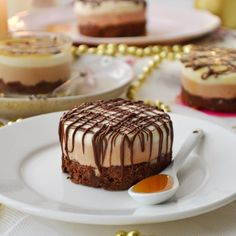 A very rich and decadent triple chocolate mousse cake with a dark chocolate cake, then a milk chocolate mousse and white chocolate mousse.