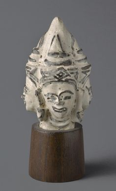 Finial with Head of Brahma  Artist/maker unknown, Thai  Geography: Made in Thailand, Asia Date: 14th-15th century Medium: Glazed stoneware; Sawankalok ware with underglaze iron decoration Dimensions: Height: 4 1/2 inches (11.4 cm) Curatorial Department: East Asian Art Object Location: Currently not on view  Accession Number: 1967-162-69