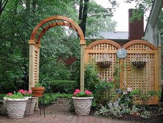 Cute little privacy screen for a back patio. Hand-built arched lattice by Elyria Fence Inc